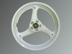 Masked, blasted, pretreated and polyester powder coated in white motorbike wheel